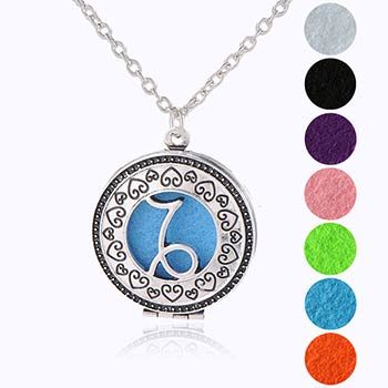 Capricorn, bijuterie parfumata cu set colier argintiu si pandantiv aromaterapie cu 4 discuri diverse culori
